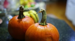 pumpkins harvest put on counter - stock footage