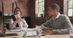 Steadicam shot in of diverse business team meeting Stock Footage
