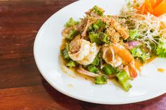 Spicy shrimp with winged bean salad Stock Photos