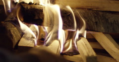 Hand moving wood in fireplace - stock footage