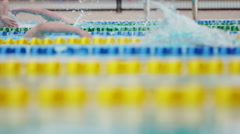 Side view of Swimmers in a Pool in Slow Motion - stock footage