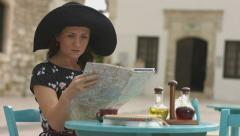 Stock Video Footage of Pretty lady studying city map, searching accommodation, hotel, restaurant, cafe