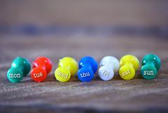 Close up weekly push pins - stock photo