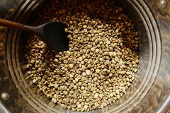 Coffee beans are roasting in pan - stock photo