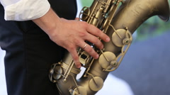 A man playing the saxophone. Close up - stock footage