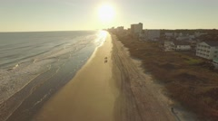 Drone beach flyover in myrtle beach sc with sunset.mp4 Stock Footage