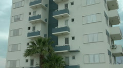 Establishing shot of multi-storey apartment building in exotic country. Realty Stock Footage