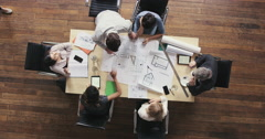 Top View of Business people meeting around boardroom table discussing Stock Footage