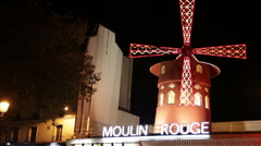 Illuminated windmill over Moulin Rouge in Paris - stock footage