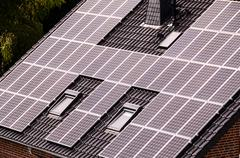 Green Renewable Energy with Photovoltaic Panels - stock photo