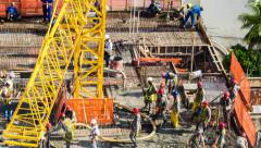 Timelapse View of Men Working at Construction Site - Zoom Out Stock Footage
