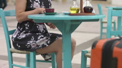 Hot young woman reading newsfeed on smartphone, checking social network in cafe Stock Footage