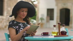 Beautiful young woman reading interesting book, marking favorite places with pen Stock Footage
