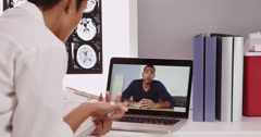 Stock Video Footage of Young doctor consulting patient online