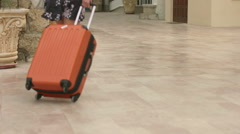 Hot lady rolling comfortable wheel suitcase on vacation, tourist trip abroad Stock Footage