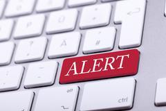 Aluminium keyboard with alert word on it Stock Photos