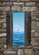 View of a sailing boat threw a window Stock Photos