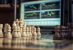 chess and forex - stock photo