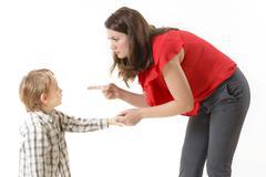 Mother disciplining her child Stock Photos