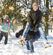Jumping over another person in wintertime - stock photo