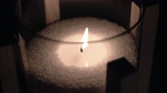 Burning candle in glass close up granulated wax Stock Footage