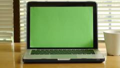 Dolly shot - Laptop computer with green screen monitor Stock Footage