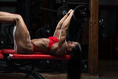 Hot Woman In Underwear Doing Exercise For Triceps - stock photo