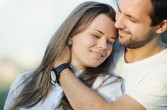 Portrait of tender sensual young couple in love posing on sunset Stock Photos