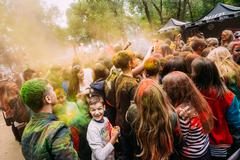 Young people having fun and dancing together at Holi color festi Kuvituskuvat