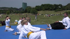 Aikido master trainer with children pupils start warming up. 4K Stock Footage