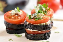 Appetizer eggplant with tomatoes and cheese Stock Photos