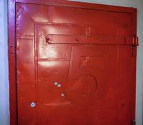 Vintage door painted red with number five - stock photo