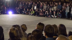 People audience watch exciting boy and girl performing modern dance. 4K Stock Footage