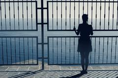 Woman  watching sea  ,dramatic view,woman on the edge ,woman silhouette unusual Kuvituskuvat