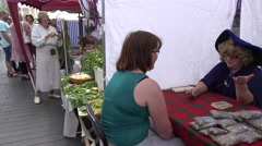 Future teller with tarot card stall in urban celebration. 4K Stock Footage