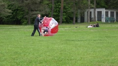 Father parent push fast his son kid in zorb ball on grass. 4K Stock Footage