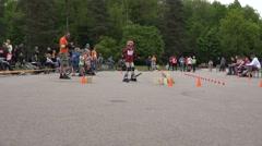 Roller skater girl kid perform in slalom and people applaud. 4K Stock Footage