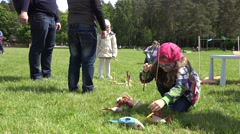 Small girl in glasses catch toy fishes with artificial rod. 4K Stock Footage