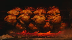 Chicken being grilled in charcoal Stock Footage