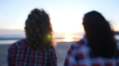 Two Girls Walking at Sunset on the Beach Stock Footage