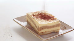 HD footage, dusting tiramisu cake with powdered cocoa Stock Footage