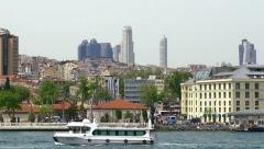 Istanbul city pan shot showing the buildings rising above Besiktas Stock Footage