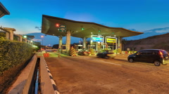 Traffic Going Through Toll Plaza At Night, Malaysia Stock Footage