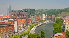 Cityscape of Bilbao in a sunny summer day time lapse Stock Footage