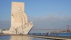 People are walking near the Monument to the Discoveries in Lisbon Stock Footage