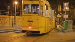 A night city - tram is departing from the stop Stock Footage