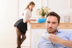 Handsome man commiting betrayal with housemaid - stock photo