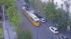 A tram is moving along the street Stock Footage