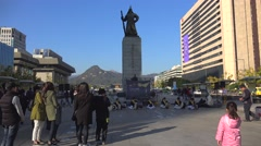 Statue of Admiral Yi Sun-sin at the Gwanghwamun Plaza & the drummers performance Stock Footage