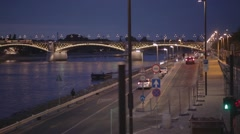 A cars and river of evening city in Budapest Stock Footage
